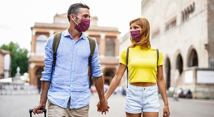 Couple traveling in times of covid wearing face masks
